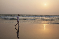 Girl walking on beach - CUF42183