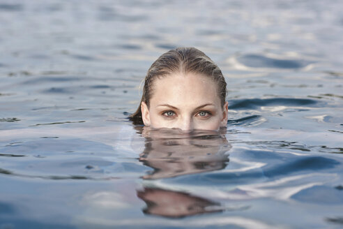 Portrait of young woman submerged in lake - CUF42342