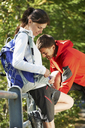 Mid adult couple out hiking - CUF42375