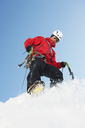 Mid adult man climbing on snow, low angle - CUF42393