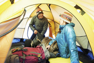 Mid adult couple in tent - CUF42399
