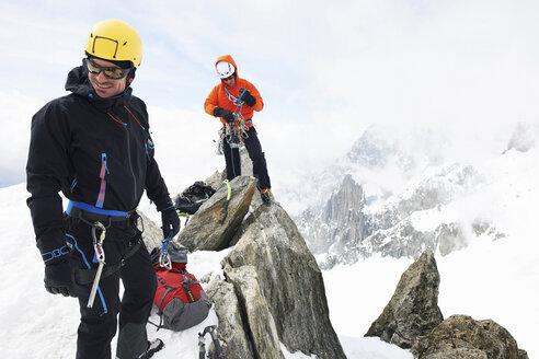 Two men rock climbing, Chamonix, France - CUF42402