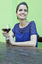 Young woman at table outside cafe with wine - CUF42513