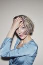Portrait of beautiful blond woman wearing evening dress - PNEF00728
