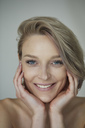 Portrait of smiling beautiful blond woman - PNEF00737