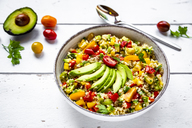 Bowl of bulgur salad with bell pepper, tomatoes, avocado, spring onion and parsley - SARF03829