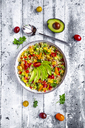 Bowl of bulgur salad with bell pepper, tomatoes, avocado, spring onion and parsley - SARF03835