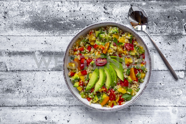 Bowl of bulgur salad with bell pepper, tomatoes, avocado, spring onion and parsley - SARF03838