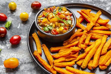 Homemade sweet potato fries and bowl of tomato basil dip - SARF03847