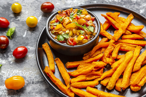 Homemade sweet potato fries and bowl of tomato basil dip - SARF03847