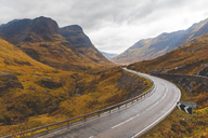 UK, Scotland, scenic road through the mountains in the Scottish highlands near Glencoe with a view on the Three Sisters - WPEF00677