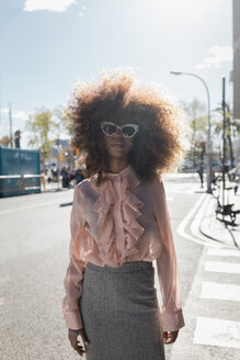 Portrait of beautiful young woman with afro hairdo in the city - MAUF01486