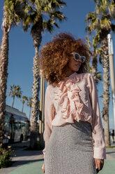 Portrait of stylish young woman at seaside promenade - MAUF01510