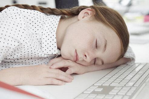 Girl asleep on computer keyboard - CUF42991
