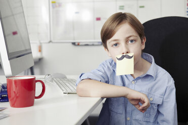 Boy with adhesive note covering mouth, drawing of moustache - CUF43003