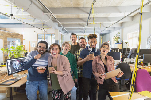 Portrait happy, playful creative business team in open plan office - CAIF21077
