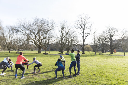 People exercising in sunny park - CAIF21158