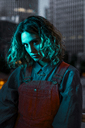 Portrait of a beautiful woman at night, wearing dungarees - KKAF01225