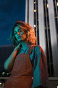 Portrait of a beautiful woman at night, wearing dungarees - KKAF01228