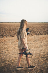 Young woman in the country side using drone - ACPF00126
