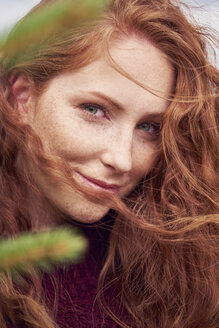 Portrait of redheaded young woman with freckles - ABIF00704