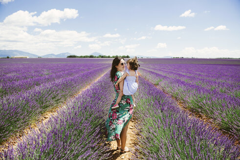 France, Provence, Valensole plateau, Mother and daughter in lavender fields in the summer - GEMF02118
