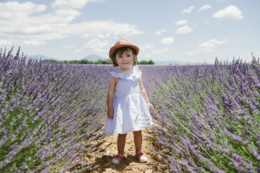 France, Provence, Valensole plateau, Happy toddler girl standing in purple lavender fields in the summer - GEMF02130