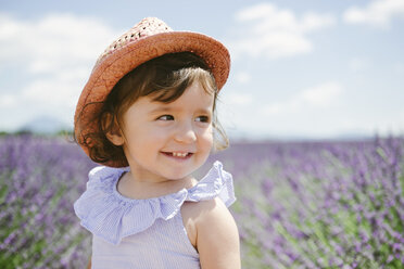 France, Provence, Valensole plateau, Happy toddler girl in purple lavender fields in the summer - GEMF02136