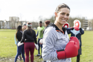 Portrait smiling, confident woman boxing in park - CAIF21194