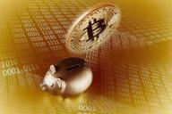 Golden Bitcoin over piggy bank - CAIF21227