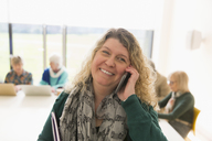 Smiling businesswoman talking on smart phone - CAIF21239