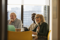 Smiling senior business people in conference room meeting - CAIF21257