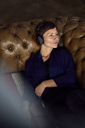 Woman with headphone lying on sofa, listening music - RBF06441