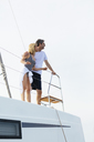 Mature couple making holidays, sailing on a catamaran - EBSF02667