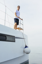 Marure man on catamaran, looking ta view - EBSF02670