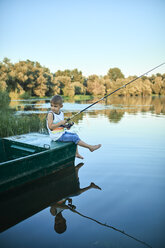 Little boy with fishing rod sitting on boat - ZEDF01494
