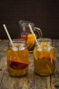 Two glasses of peach orange ice tea on wood - LVF07306
