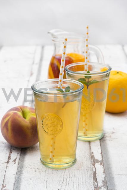 Two glasses of peach orange ice tea - LVF07309