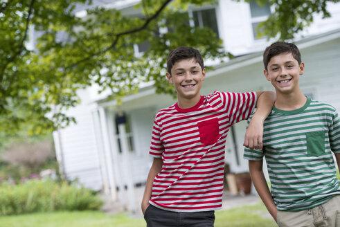 Two boys in a farmhouse garden in summer. - MINF00302