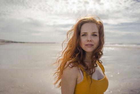 Netherlands, Zeeland, portrait of redheaded woman on the beach - KNSF04190