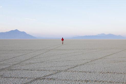 A man in the flat playa, salt pan, of Black Rock Desert, Nevada. - MINF00500