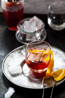 Negroni with orange peel and ice cubes - SBDF03682