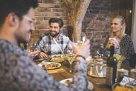 Family and friends enjoying dinner, eating, drinking, having fun - AWF00108