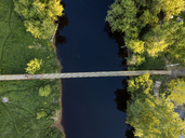 Russia, Leningrad Oblast, Tikhvin, Aerial view of Tikhvinka River and bridge - KNTF01152
