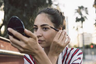 Portrait of woman applying mascara - AFVF00852