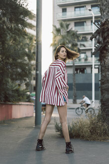 Portrait of woman wearing striped shirt - AFVF00861