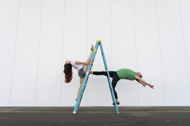 Two acrobats doing tricks on a ladder - AFVF00897