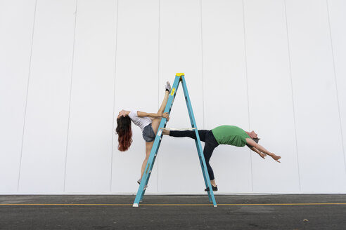 Two acrobats doing tricks on a ladder - AFVF00897