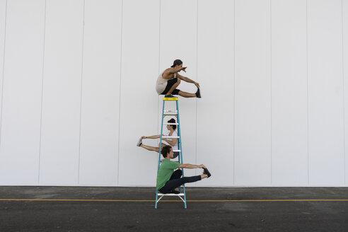 Three acrobats doing tricks on a ladder - AFVF00903