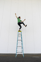Acrobat balancing on ladder - AFVF00906